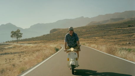 Easy rider cruising with his vespa in the mountains of gran canaria for TV commercial of Star Tour filmed by Seven Islands Film